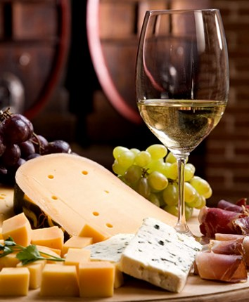 a glass of wine and cheese